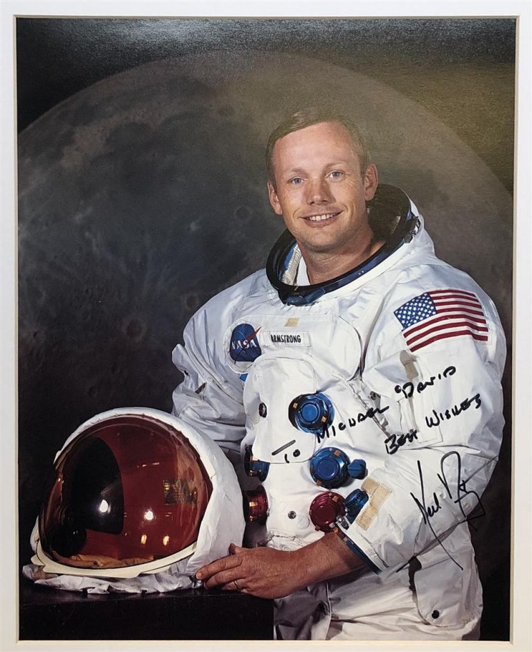 Autographed color photo signed in full by the American Astronaut and Aeronatical Engineer who became the first man to walk on the Moon. Neil ARMSTRONG.