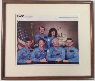 Framed NASA photograph signed by the entire six-member crew. SPACE SHUTTLE DISCOVERY -- 1st Mission