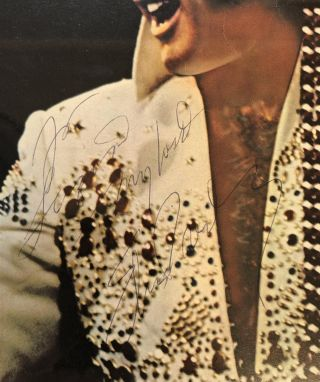 Signed Photograph and Concert Map in a double-sided frame. Elvis PRESLEY, 1935 - 1977